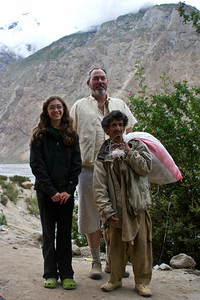 This is Anisa and Matthew with one of our porters: the Chairman, for some size reference.  He was a great guy, and despite his diminutive stature, carried just as heavy a load as the rest of the porters and always had a great attitude.