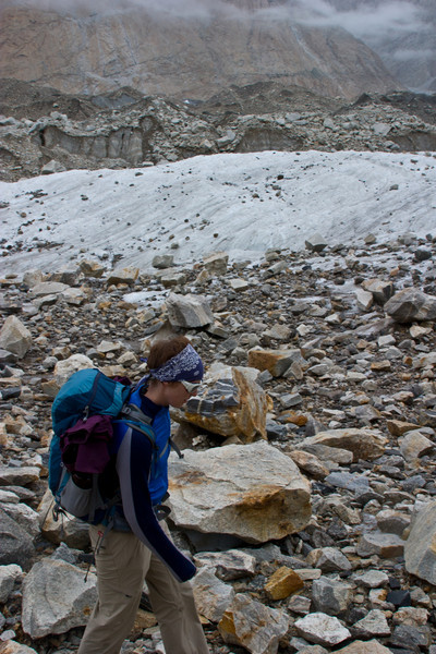 Erin walks the rocky trail as we start seeing more naked glacier.