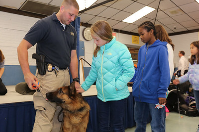 Students say hello to Ale and Trooper Greg Fascendini.  Photo by John Fitts