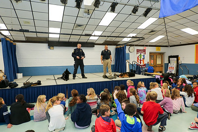 From left Erol, T.F.C. Lance Carlson, Trooper Greg Fascendini and Ale at a recent Kids Care Club meeting at Canton Intermediate School. Photo by John Fitts