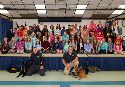 Erol, T.F.C. Lance Carlson, Trooper Greg Fascendini and Ale at a recent Kids Care Club meeting at Canton Intermediate School. Photo by John Fitts
