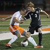Erik Anderson - For the Elburn Herald<br /> Kaneland's Tyler Siebert battles for possession of the ball with an opposing DeKalb player during the match up at DeKalb High School on Tuesday, September 17, 2013.