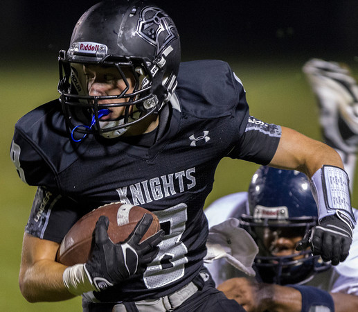 Erik Anderson - For the Elburn Herald<br /> The Knights Brandon Bishop carries the ball downfield as Kaneland hosted IC Catholic Prep in Maple Park on Friday, September 6, 2013. Kaneland defeated IC Catholic Prep 45-14 on Friday night.