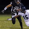 Erik Anderson - For the Elburn Herald<br /> The Knights Dylan Nauert carries the ball during the first quarter as Kaneland hosted IC Catholic Prep in Maple Park on Friday, September 6, 2013. Kaneland defeated IC Catholic Prep 45-14 on Friday night.