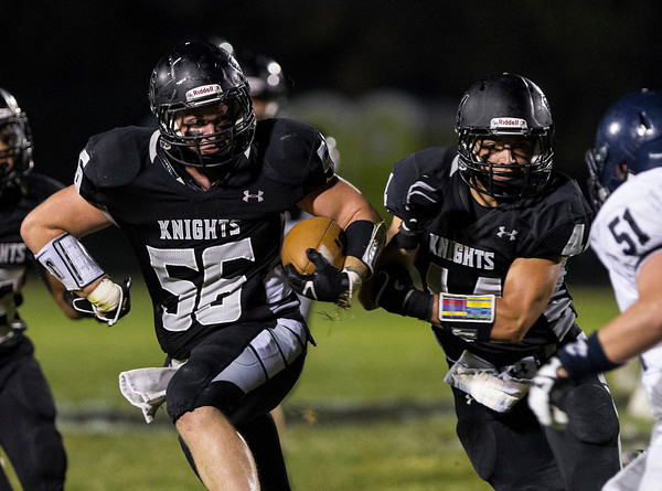 Erik Anderson - For the Elburn Herald<br /> The Knights Sam Bower (56) runs downfield after making an interception during early gameplay action as Kaneland hosted IC Catholic Prep in Maple Park on Friday, September 6, 2013. Kaneland defeated IC Catholic Prep 45-14 on Friday night.