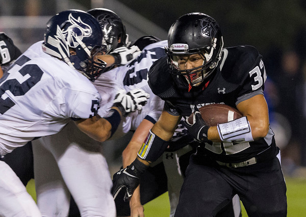 Erik Anderson - For the Elburn Herald<br /> The Knights running back Nate Dyer carries the ball past the defensive line during the first half as Kaneland hosted IC Catholic Prep in Maple Park on Friday, September 6, 2013. Kaneland defeated IC Catholic Prep 45-14 on Friday night.