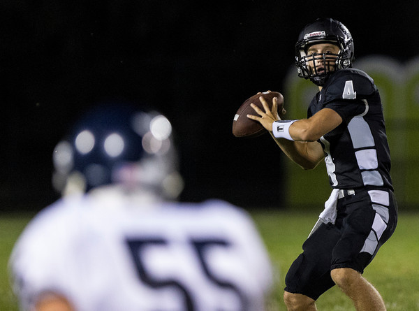 Erik Anderson - For the Elburn Herald<br /> Kaneland quarterback Drew David looks for a pass during the first half as Kaneland hosted IC Catholic Prep in Maple Park on Friday, September 6, 2013. Kaneland defeated IC Catholic Prep 45-14 on Friday night.