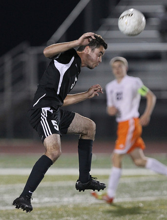 Erik Anderson - For the Elburn Herald<br /> Kaneland's Anthony Parillo headbutts the ball during the second half of the game during the match up at DeKalb High School on Tuesday, September 17, 2013.