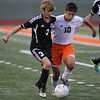 Erik Anderson - For the Elburn Herald<br /> Kaneland's Tyler Siebert battles with an opposing DeKalb player during early gameplay action during the match up at DeKalb High School on Tuesday, September 17, 2013.
