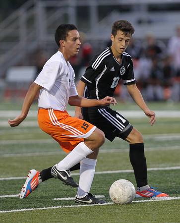 Erik Anderson - For the Elburn Herald<br /> Kaneland's Arsim Azemi battles for possession of the ball against an opposing DeKalb player during the match up at DeKalb High School on Tuesday, September 17, 2013.