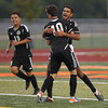 Erik Anderson - For the Elburn Herald<br /> Kaneland's Ignacio Toscano hugs team mate Arsim Azemi (10) after a goal during the match up at DeKalb High School on Tuesday, September 17, 2013.