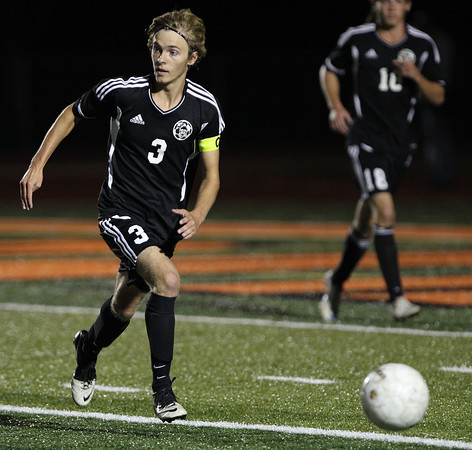 Erik Anderson - For the Elburn Herald<br /> Kaneland's Tyler Siebert looks downfield while dribbling the ball during late gameplay action during the match up at DeKalb High School on Tuesday, September 17, 2013.