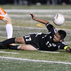 Erik Anderson - For the Elburn Herald<br /> Kaneland's Ivan Bohorquez slides into an opposing DeKalb player in an attempt to gain possession of the ball during the match up at DeKalb High School on Tuesday, September 17, 2013.