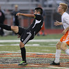 Erik Anderson - For the Elburn Herald<br /> Kaneland and DeKalb battle during an even level game during the match up at DeKalb High School on Tuesday, September 17, 2013.