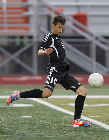 Erik Anderson - For the Elburn Herald<br /> Kaneland's Arsim Azemi kicks the ball downfield during the first half of the game during the match up at DeKalb High School on Tuesday, September 17, 2013.