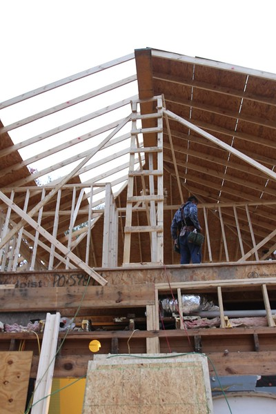building a 1600 ft addition with no ceiling joists, what do you think will happen?