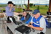 Our President, Larry K6SPP takes photos as Mark N7MA runs the logging computer and  Jim ADØAZ reaches out to make some contacts.