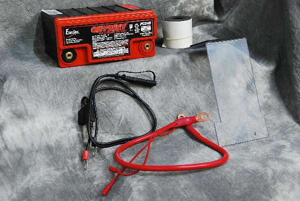 """The compelte Happy Trails Odyssey Battery Kit HTP4-8-30 includes: (1) PC545 Odyssey Battery; (2) 21"""" of foam tape; (3) a laminar clear battery cover; (4) custom fitted positive and negative cables (neg not pictured) (5) bullet terminals; (6) an SAE battery tender harness."""