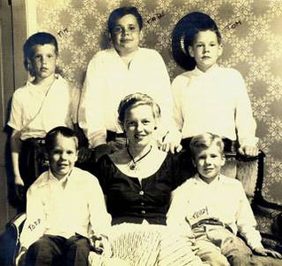 One of my favorite photographs of my grandmother and her five boys (my dad, top center, and uncles).  I have no idea who decided to write the names of everyone in ink on the printed photo, but it makes me smile too.