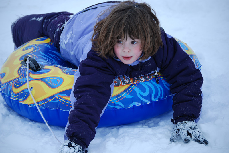 "Niece Isabel (in Wisconsin), ""tubing"" in the snow."