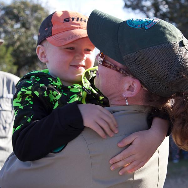 A hug for mom before she helps lead the hike