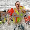 Luke VanMeter, a member of the Little Rock-Fox Fire Protection District, emerges from the figid water after completely dunking himself during the annual Polar Plunge to benefit Special Olympic athletes on Loon Lake at Silver Springs State Park in Yorkville on Sunday, March 5, 2017. Steven Buyansky for Shaw Media
