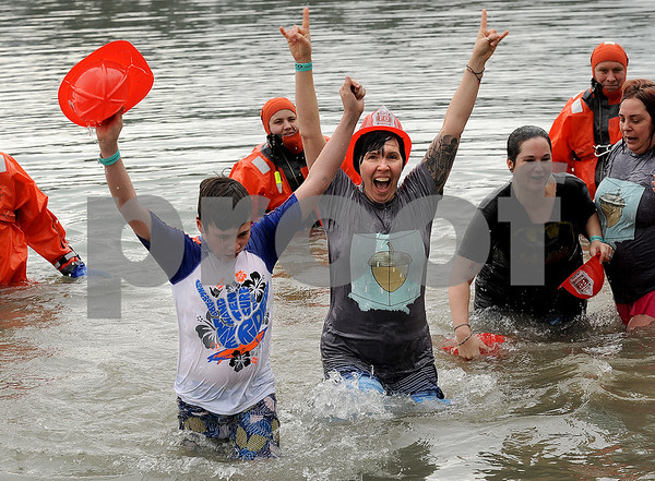 "Fourteen-year-old Cole Okapal and his mom Stehanie of Sandwich of team ""Frozen Nuts"" celebrate their dunking during the annual Polar Plunge to benefit Special Olympic athletes on Loon Lake at Silver Springs State Park in Yorkville on Sunday, March 5, 2017. Steven Buyansky for Shaw Media"