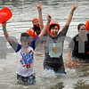 """Fourteen-year-old Cole Okapal and his mom Stehanie of Sandwich of team """"Frozen Nuts"""" celebrate their dunking during the annual Polar Plunge to benefit Special Olympic athletes on Loon Lake at Silver Springs State Park in Yorkville on Sunday, March 5, 2017. Steven Buyansky for Shaw Media"""