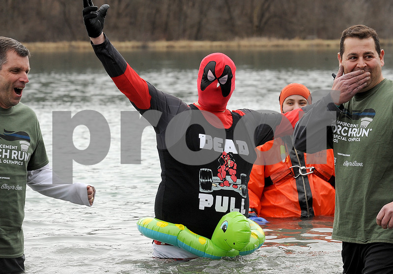 Dead Pool, aka Jonathon Jones of the West Chicago Police Department, thrills the crowd before dunking himself in the frigid lake water during the annual Polar Plunge to benefit Special Olympic athletes on Loon Lake at Silver Springs State Park in Yorkville on Sunday, March 5, 2017. Steven Buyansky for Shaw Media