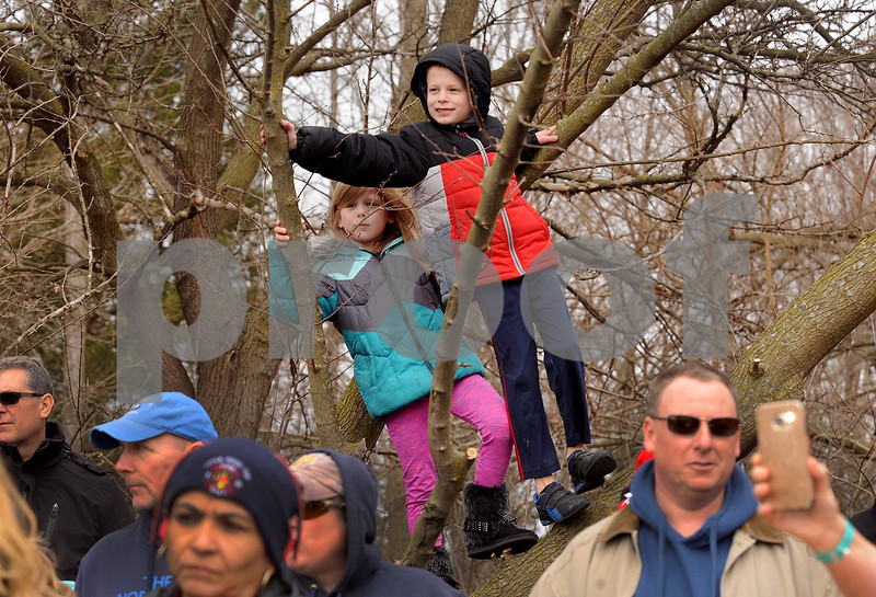 Seven-year-old Evelyn Blomberg and her 8-year-old brother John of Yorkville get a birds-eye view of the plungers during the annual Polar Plunge to benefit Special Olympic athletes on Loon Lake at Silver Springs State Park in Yorkville on Sunday, March 5, 2017. Steven Buyansky for Shaw Media