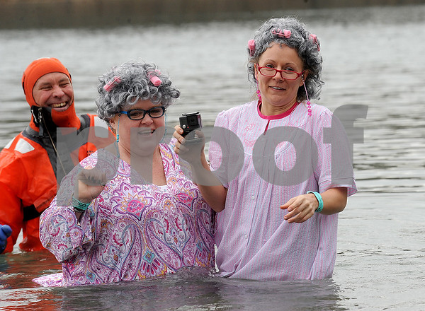 Members of the Golden Coldies, Shelley Lemons (left) and Jen Marsh, representing the Kane County Emergency Communications dispatch center were the last to dip into the cold lake water during the annual Polar Plunge to benefit Special Olympic athletes on Loon Lake at Silver Springs State Park in Yorkville on Sunday, March 5, 2017. Steven Buyansky for Shaw Media