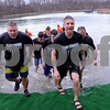 Team Oswego, including members of the Police Department, their families and Police Explorers program, exit the cold water during the annual Polar Plunge to benefit Special Olympic athletes on Loon Lake at Silver Springs State Park in Yorkville on Sunday, March 5, 2017. Steven Buyansky for Shaw Media