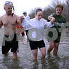 Special Olympian Laura Bosshardt of Sycamore gets help navigating the frigid waters during the annual Polar Plunge to benefit Special Olympic athletes on Loon Lake at Silver Springs State Park in Yorkville on Sunday, March 5, 2017. Steven Buyansky for Shaw Media
