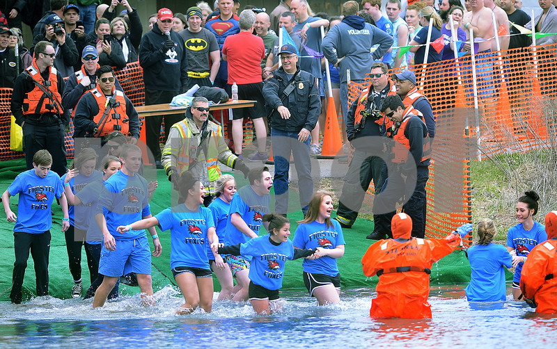 The Frosted Foxes, consisting of members of the Yorkville High School Student Council, enter the 40 degree water during the annual Polar Plunge to benefit Special Olympic athletes on Loon Lake at Silver Springs State Park in Yorkville on Sunday, March 5, 2017. Steven Buyansky for Shaw Media