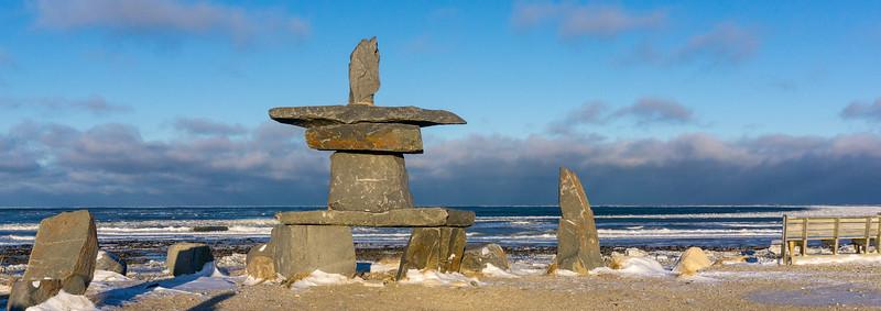 Inukshuk in Churchill at the edge of Hudson Bay