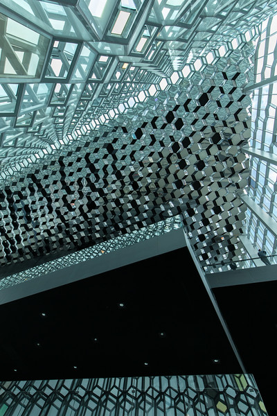 The Escher-like glass walls and ceiling of the Harpa Concert Hall in Reykjavik, Iceland.