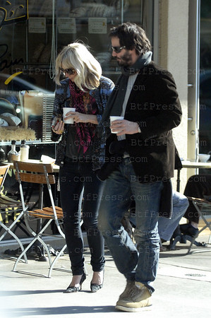 Keanu Reeves with a mysterious girlfriend in Brentwood, California.