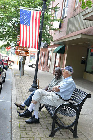 Two old friends chatting on the square in downtown Glasgow, KY