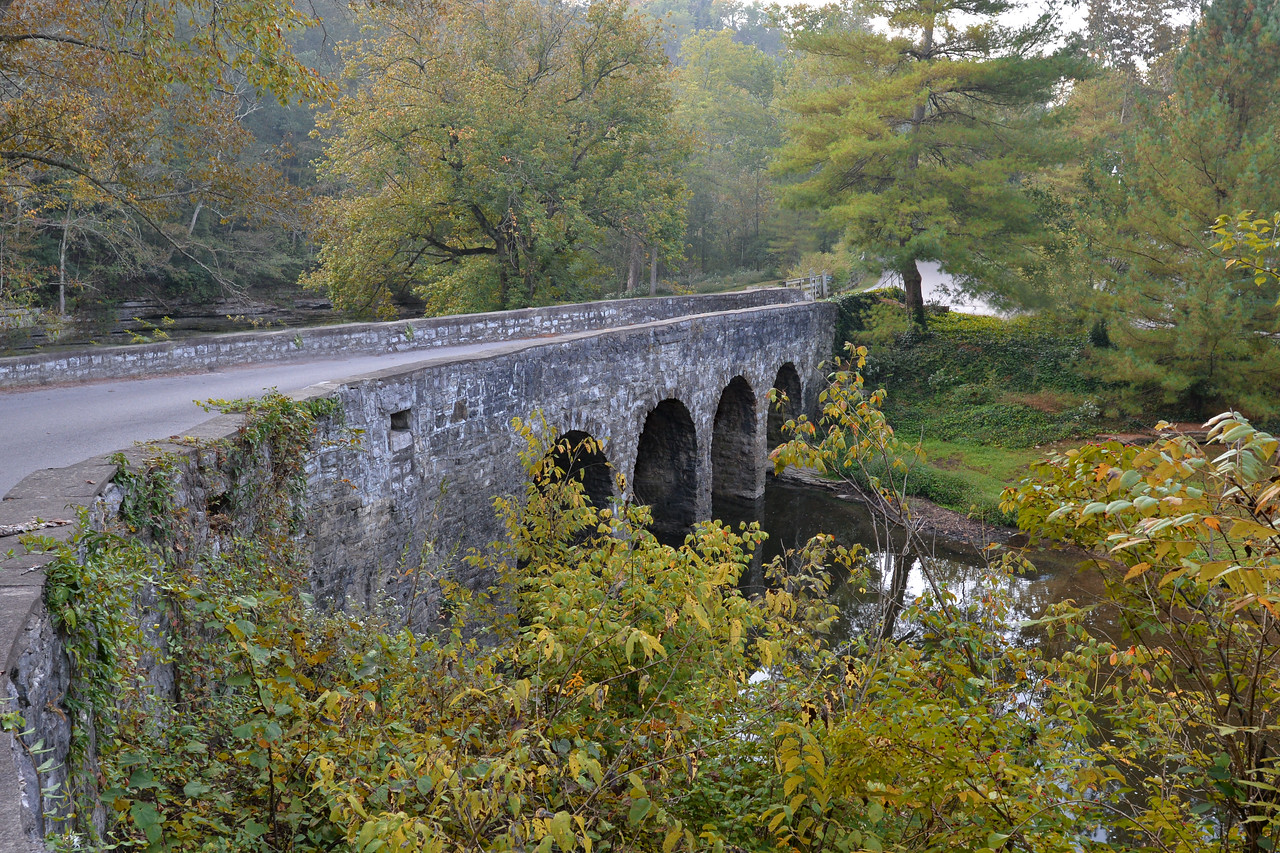 """Glass Mill Bridge located in Wilmore, KY is a four-span stone arch bridge over Jessamine Creek. The European style limestone bridge was part of a Works Progress Administration project in the mid-1930s. The bridge is among some of the Kentucky scenes photographed by James Archambeault several years ago. I enjoy Mr. Archambeault's books very much and after reading Kentucky, Kentucky II & Kentucky III, I realized that I too have visited and photographed many of the same """"Kentucky scenes"""" that he mentions in his books. I've never met him but his books certainly inspire me!  In June 1933, The Public Works Administration, in response to the Great Depression, built large-scale public works such as dams, bridges, hospitals, and schools. Its goals were to spend $3.3 billion in the first year, and $6 billion in all, to provide employment, stabilize purchasing power, and help revive the economy. Most of the spending came in two waves in 1933-35, and again in 1938. Originally called the Federal Emergency Administration of Public Works, it was renamed the Public Works Administration in 1935 and shut down in 1944."""