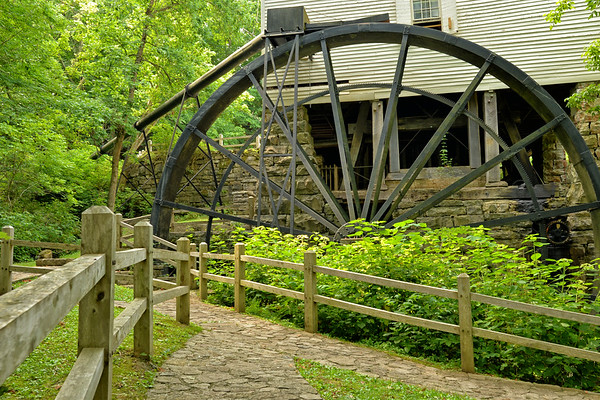 Mill Springs Mill, a water-powered grist mill listed on the National Register of Historic Places, was built in 1877 and is on the public lands of Lake Cumberland near Monticello, KY.  It's 40-foot overshot water wheel is one of the largest in the world and probably the largest water wheel currently operating. The mill and water wheel were restored as a bicentennial project in 1976.