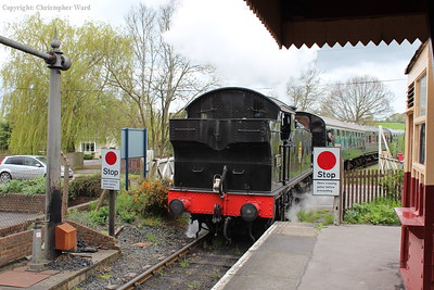 4247 runs in over the level crossing