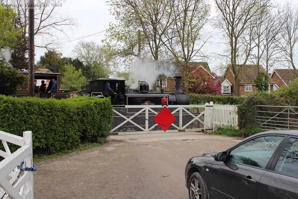 32670 crosses the level crossing at Tenterden