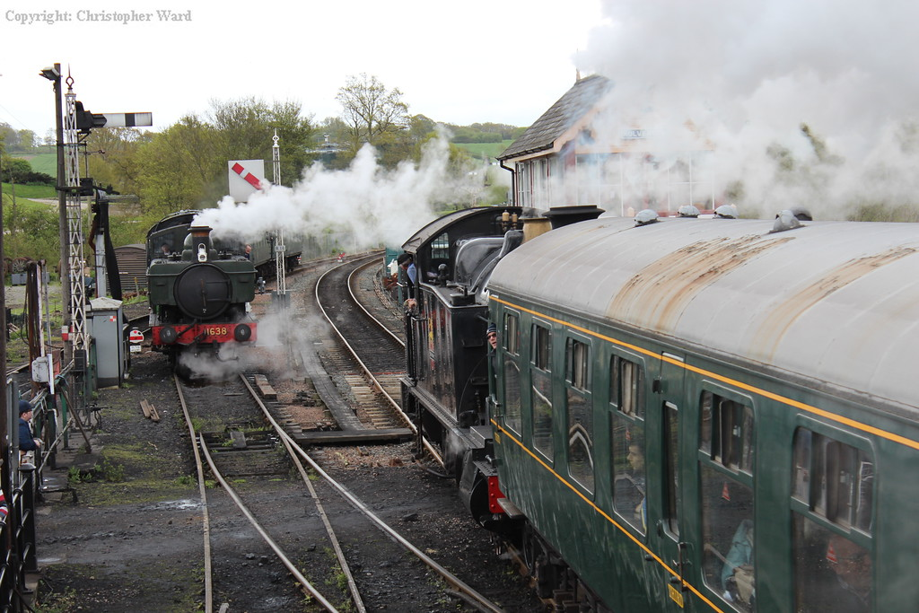 GWR heritage as the 42xx pulls out and passes the Pannier tank
