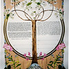 K 013 - Tree trunk separates Hebrew and English text with Jerusalem in the roots of the tree.  Apple blossoms on top of tree and spring flowers complete the design