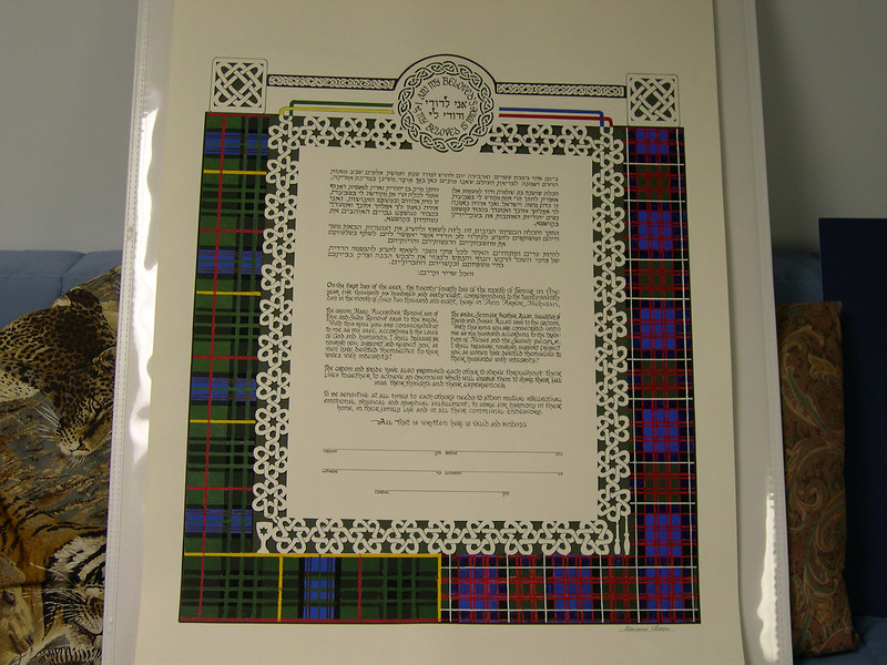 "KPC 04 - Bride and groom were both of Scottish descent and these were their plaids.  Also they wanted ""Irish knots"" and I did those in paper cut on top and border around Ketubah."