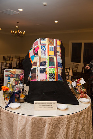 Lap quilt made by Rosalie Caswell-Bohman. All raffle items were donated by the Reunion Committee.