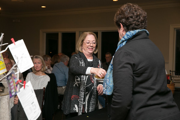 Joan Daigneault-Page , draws the final winning ticket