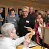 Lucy Leo-Ashmore and Rosalie Caswell-Bohman selling raffle tickets toJanice Dziki-Blanchette, Carol Desrosiers-Caron, Deb Davis and Betty Jo Solomon-Pakulis