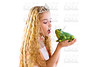 blond princess girl kissing a frog green toad