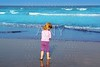 little blond beach girl rear view sea turquoise